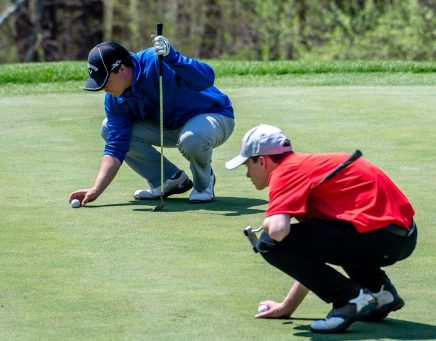 Lewis Mills' Jon Ventres, left, and Northwestern's Brian Keegan, right, line up their balls as they prepare to putt on the 16th hole during the Woodland Individual golf tournament held Thursday at Oxford Greens in Oxford. 20 schools from throughout the state completed in the tournament. Jim Shannon Republican American