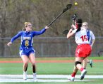 #8 Genevieve Bushey of Housatonic Valley Regional High battles for the ball against #15 Cianna Navarro of Wolcott High during Lacrosse action in Wolcott Thursday. Steven Valenti Republican-American