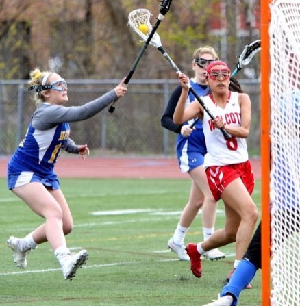 #16 Madison Simonds of Housatonic Valley Regional High tries to stop #8 Alex Arteaga of Wolcott High as she shoot on goal during Lacrosse action in Wolcott Thursday. Steven Valenti Republican-American