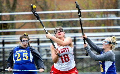 #18 Adriana Ferrucci of Wolcott High tries to control the ball as #16 Madison Simonds and #25 Kaylyn Vogel of Housatonic Regional High defend during Lacrosse action in Wolcott Thursday. Steven Valenti Republican-American