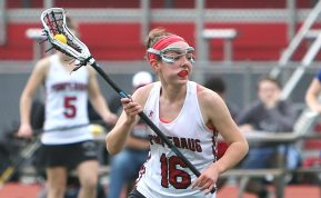 Pomperaug High School's Mia Sullivan runs the ball up the field during the girls varsity lacrosse game against Fairfield Ludlowe in Southbury on Saturday afternoon. Emily J. Reynolds. Republican-American