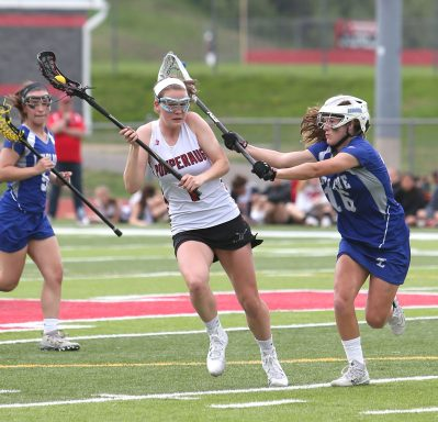 Pomperaug High School's Kathleen Schenk battles a defender on her way up the field during the girls varsity lacrosse game against Fairfield Ludlowe in Southbury on Saturday afternoon. Emily J. Reynolds. Republican-American