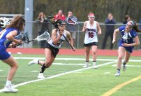 Pomperaug High School's Camden Frissora makes a break for the goal during the girls varsity lacrosse game against Fairfield Ludlowe in Southbury on Saturday afternoon. Emily J. Reynolds. Republican-American
