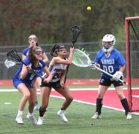 Pomperaug High School's Camden Frissora battles for the ball in front of the opposing net during the girls varsity lacrosse game against Fairfield Ludlowe in Southbury on Saturday afternoon. Emily J. Reynolds. Republican-American