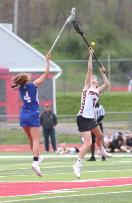 Pomperaug High School's Kathleen Schenk fights for the ball on the faceoff during the girls varsity lacrosse game against Fairfield Ludlowe in Southbury on Saturday afternoon. Emily J. Reynolds. Republican-American