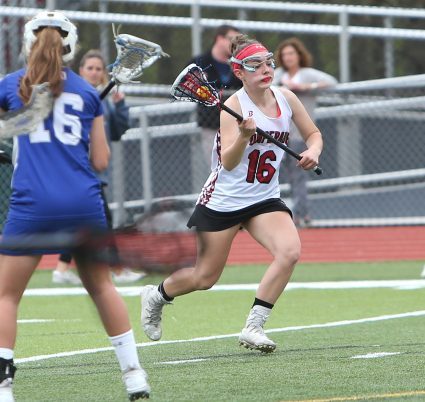 Pomperaug High School's Mia Sullivan makes a break for the goal during the girls varsity lacrosse game against Fairfield Ludlowe in Southbury on Saturday afternoon. Emily J. Reynolds. Republican-American