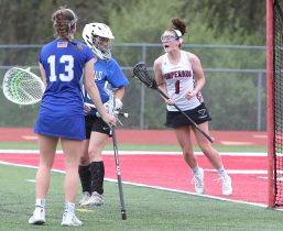 Pomperaug High School's Kathleen Schenk celebrates a goal during the girls varsity lacrosse game against Fairfield Ludlowe in Southbury on Saturday afternoon. Emily J. Reynolds. Republican-American