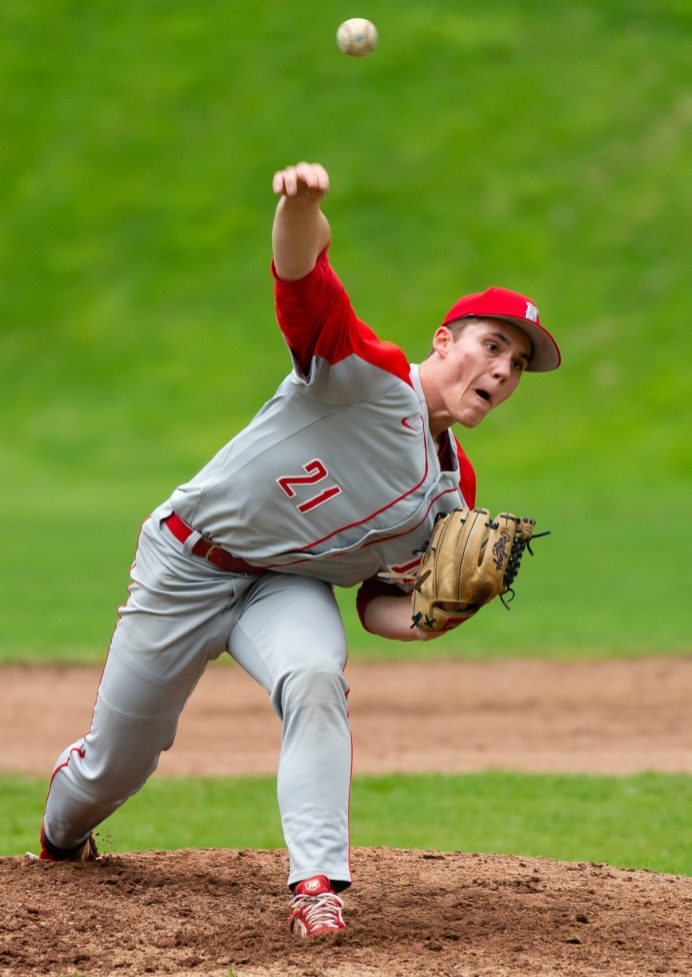 Northwestern's Drew Warren (21) delivers a pitch during their Berkshire League game against Lewis Mills Monday at Northwestern in Winsted. Jim Shannon Republican American