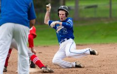 Lewis Mills' Devin Shaffer (2) slides in safely into third base in front of a tag by Northwestern's Zach West (10) during their Berkshire League game Monday at Northwestern in Winsted. Jim Shannon Republican American