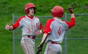 Northwestern's Joey Grantmeyer (3) is congratulated by teammate Mike Bobinski (4) after blasting a solo home run during their Berkshire League game against Lewis Mills Monday at Northwestern in Winsted. Jim Shannon Republican American