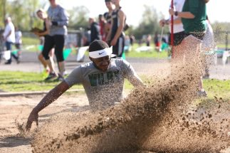 Wilby High School's Trae Pratt competes in the long jump during the three school track meet between Wilby, Woodland, and Derby at Woodland Regional High School on Tuesday afternoon. Emily J. Reynolds. Republican-American
