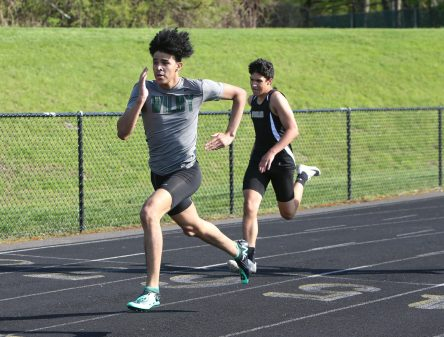 Wilby High School's Isaac Smith wins the boys 400 meter race during the three school track meet between Wilby, Woodland, and Derby at Woodland Regional High School on Tuesday afternoon. Emily J. Reynolds. Republican-American