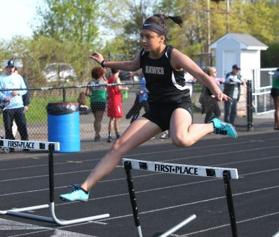 Woodland Regional High School's Isabela Mejias competes in the girls hurdles during the three school track meet between Wilby, Woodland, and Derby at Woodland Regional High School on Tuesday afternoon. Emily J. Reynolds. Republican-American