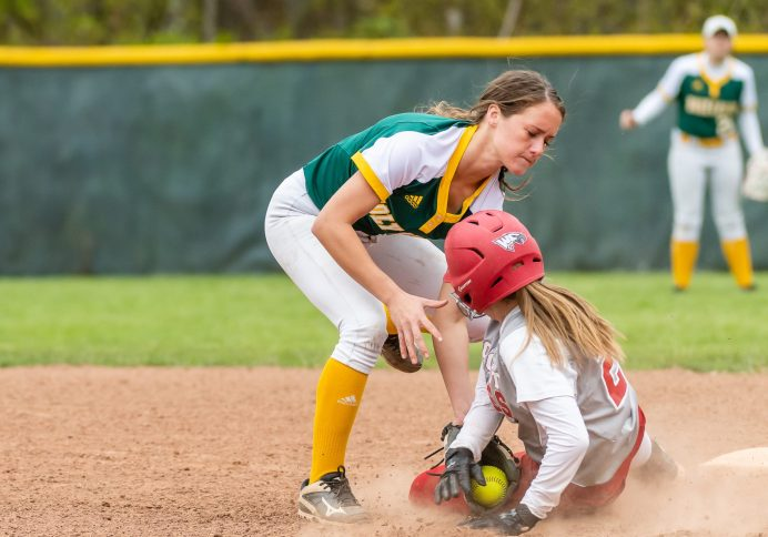 Holy Cross' Allie Brown #1 reaches out to catch the ball and tag out Wolcott's Kayla Nuehlan #21, at second base, during a Girls NVL softball game between Holy Cross and Wolcott at Wolcott High School in Wolcott on Thursday. Holy Cross held on to win 4-2. Bill Shettle Republican-American