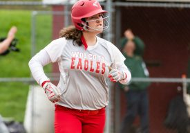 Wolcott's Jose Cammarata #22 rects after hitting a ball over the fence just foul by inches, during a Girls NVL softball game between Holy Cross and Wolcott at Wolcott High School in Wolcott on Thursday. Holy Cross held on to win 4-2. Bill Shettle Republican-American