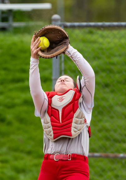 Wolcott's catcher Lexi Boyce #13 catches a pop fly in front of home plate, during a Girls NVL softball game between Holy Cross and Wolcott at Wolcott High School in Wolcott on Thursday. Holy Cross held on to win 4-2. Bill Shettle Republican-American