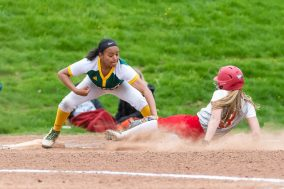 Holy Cross' Brianna Greenlaw #11, left, tags out Wolcott's Kennedy White #3, trying to get to third on a fielders choice to the infield, during a Girls NVL softball game between Holy Cross and Wolcott at Wolcott High School in Wolcott on Thursday. Holy Cross held on to win 4-2. Bill Shettle Republican-American