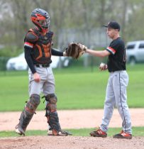 Terryville High School's pitcher, Colby Rheault, and catcher, Colin Bamrick, bump gloves on the mound at the start of an inning during the boys varsity baseball game at Wamogo against Terryville High School on Thursday afternoon. Emily J. Reynolds. Republican-American