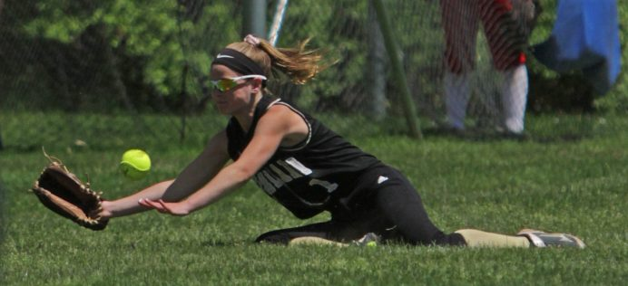 Woodland's Chelsea Donovan (1) dives after a foulball against Saint paul at Saint Paul Catholic High School in Bristol Saturday afternoon. Saint Paul defeated Woodland 17-14. Michael Kabelka / Republican-American