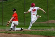 Watertown's Bailey Boivin #22, left, scoops up a short throw to him out of the dirt getting the out on Wolcott's Alex Calabro #26, during a NVL Baseball game between Watertown and Wolcott at Wolcott High School in Wolcott on Wednesday. Bill Shettle Republican-American
