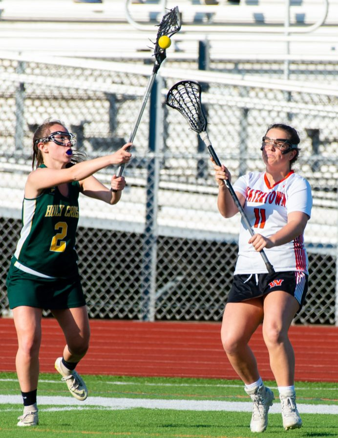 Holy Cross' McKenna Ellsworth (2) catches the ball in front of Watertown's Elizabeth Schweyer (11) during their lacrosse match Wednesday at Watertown High School. Jim Shannon Republican American