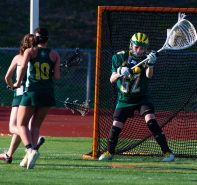 Holy Cross' Rachael Honegger (62) makes a save during their lacrosse match with Watertown Wednesday at Watertown High School. Jim Shannon Republican American
