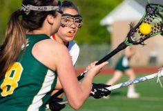 Watertown's Brianna Lucarelli (1) looks to the the ball back after loosing it to Holy Cross' Morgan Murray (8) during their lacrosse match Wednesday at Watertown High School. Jim Shannon Republican American