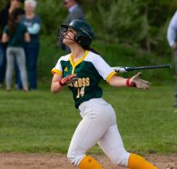 Holy Cross' Lizzie Diorio (14) rips a base hit during their NVL game against Seymour Thursday at Holy Cross High School. Jim Shannon Republican American