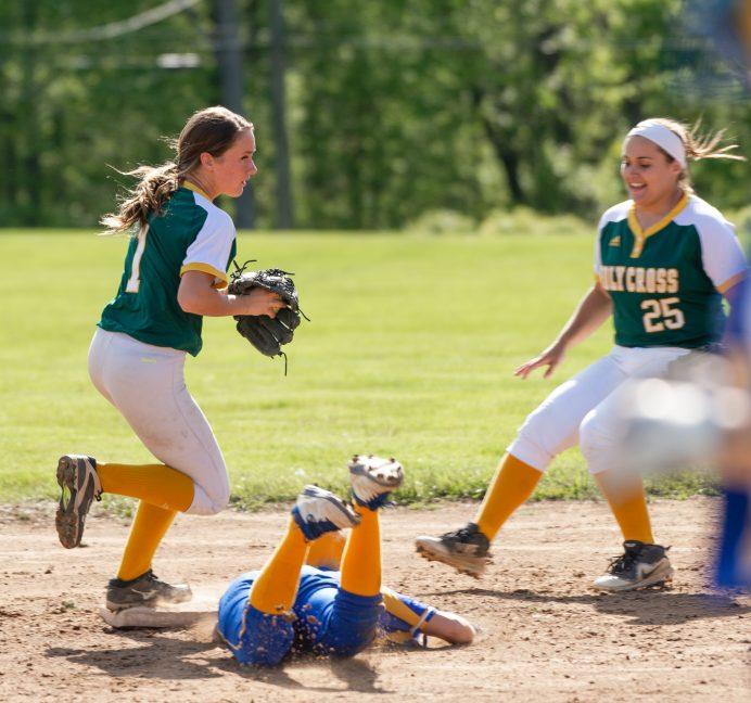 Holy Cross' Allie Brown (1), turns an unassisted double play after getting Seymour's Alyssa Johnson (3) out at second base, as teammate Valerie Nobrega (25) looks on during their NVL game Thursday at Holy Cross High School. Jim Shannon Republican American