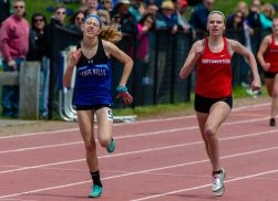 Lewis Mills' Lauren Searle outruns Northwestern's Emma Propfe to win the 400m run during Berkshire League Track and Field Championships Saturday at Litchfield High School. Jim Shannon Republican American