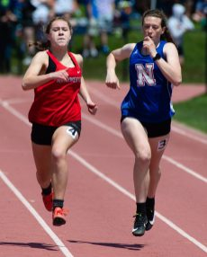 Northwestern's Hannah Gibbs, left, outpaced Nonnewaug's Azria Malloy to win the 200m run during Berkshire League Track and Field Championships Saturday at Litchfield High School. Jim Shannon Republican American