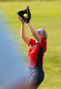 Northwestern's Megan Griswald (12) parks under a pop fly during their Berkshire League game against Wamogo Monday at Northwestern. Jim Shannon Republican American