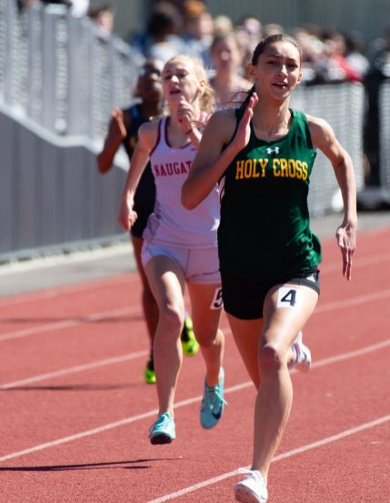 Holy Cross' Raquel Rosa won the 200m run during the NVL Track and Field Championships held Tuesday at Torrington High School. Jim Shannon Republican American