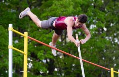 """Naugatuck's Zach Koslosky clears 12' 6"""" while competing in the pole vault during the NVL Track and Field Championships held Tuesday at Torrington High School. Jim Shannon Republican American"""