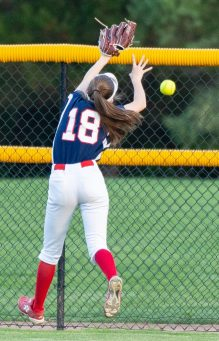 St. Paul's Caleigh Mcdougall (18) tries to make a leaping catch on a hit by Seymour's Lauren Haversat (2) during their NVL tournament semifinal game Wednesday at Seymour High School. Haversat would get a double on the play. Jim Shannon Republican American