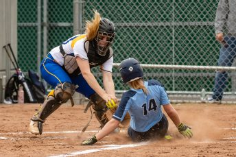 Oxford's Kaylee Dolan #14 slides into home plate ahead of the tag by Seymour's Kolby Sirowich #15, for the games first run, during a Girls Softball NVL Championship game between Oxford and Seymour at Naugatuck High School in Naugatuck on Thursday. Oxford won in extra innings over Seymour 11-6 and wins the NVL Girls Softball Championship for 2019. Bill Shettle Republican-American