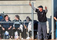 Oxford head coach Jim Husar calls out instruction to his players from the dug out, during a Girls Softball NVL Championship game between Oxford and Seymour at Naugatuck High School in Naugatuck on Thursday. Oxford won in extra innings over Seymour 11-6 and wins the NVL Championship for 2019. Bill Shettle Republican-American