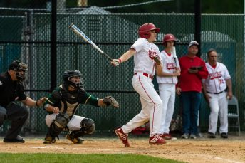 Wolcott's Dane Hassan #3 watches his ball sail into the outfield for an rbi hit, during the NVL championship game between Holy Cross and Wolcott at Municipal Stadium in Waterbury on Friday. Wolcott beat Holy Cross 10-3 to win the 2019 NVL Baseball Championship. Bill Shettle Republican-American