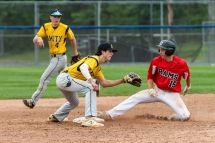 Cheshire's Ryan Strollo #15, slides safely into second after stealing the base, in front of Amity's Sebastian Formica #2, with Amity's Tanner Santos #4 looking on, during the SCC championship game between Amity and Cheshire at Piurek Field in West Haven on Saturday. Bill Shettle Republican-American