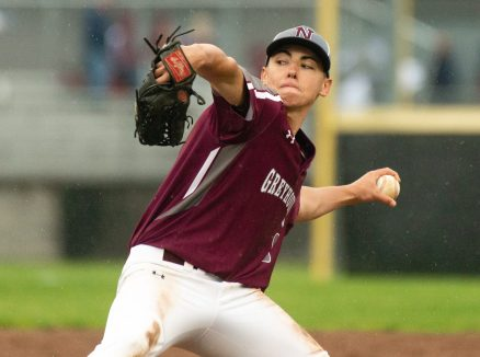 Naugatuck's Nate Deptula (9) delivers a pitch during their Class LL first round tournament game against Brien McMahon Tuesday at Naugatuck High School. Jim Shannon Republican American