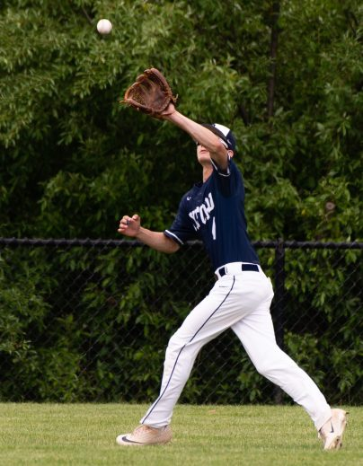 Oxford's Matt Michaud (4) make a running catch on a fly ball during their Class S tournament game against Wamogo Wednesday at Oxford High School. Jim Shannon Republican American