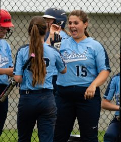Oxford's Rose Reitmeyer (22) is congratulated by teammate Sophie Kritemeyer (15) after coming in to score on a hit by Molly Sastram (10) during their Class M tournament game against Nonnewaug Wednesday at Oxford High School. Jim Shannon Republican American