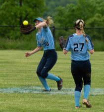 Oxford's Molly Sastram (10) makes a running catch as teammate (27) looks on Madison Sastram (27) during their Class M tournament game against Nonnewaug Wednesday at Oxford High School. Jim Shannon Republican American