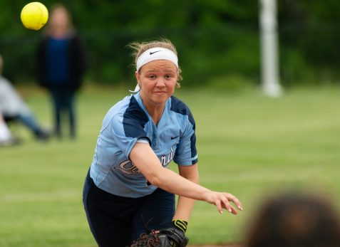 Oxford's Kaylee Dolan (14) throws to first for the out during their Class M tournament game against Nonnewaug Wednesday at Oxford High School. Jim Shannon Republican American