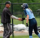 Oxford's Molly Sastram (10) is congratulated by coach Jim Husar after ripping a three RBI bases loaded triple during their Class M tournament game against Nonnewaug Wednesday at Oxford High School. Jim Shannon Republican American
