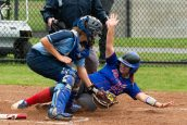 Nonnewaug's Maya Brazauskas (23) slides into home to score under the tag by Oxford's Kaylee Cuomo (2) during their Class M tournament game Wednesday at Oxford High School. Jim Shannon Republican American