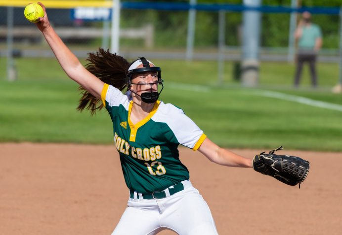 Holy Cross' Brandi McIntosh(13) delivers a pitch during their Class S semi-final game with Coginchaug Monday at West Haven High School. Jim Shannon Republican American