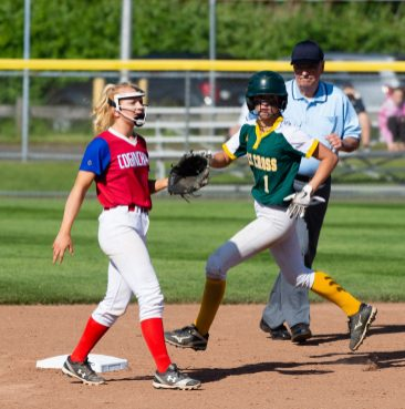 Holy Cross' Allie Brown (1) looks for extra bases after getting to second base in front of Coginchaug's Caroline Fournier (4) during their Class S semi-final game with Monday at West Haven High School. Jim Shannon Republican American