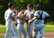 Shepaug' pitcher Jack Kennedy (13) is congratulated by teammates after pitching out of a jam during their Class S semifinal game against Holy Cross Tuesday at Sage Park in Berlin. Jim Shannon Republican American