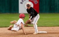 Wolcott's Alex James (10) is tagged out by Woodland's Zack Bedryczuk (12) after over sliding second base during their Class M semifinal game Tuesday at Muzzy Field in Bristol. Jim Shannon Republican American